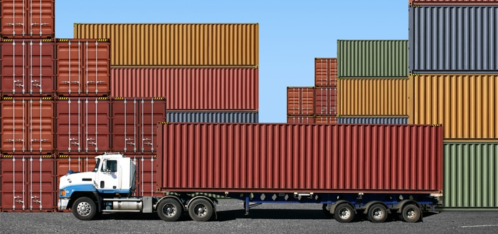 Image of Shipping containers on trucks