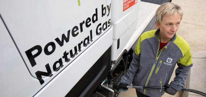 Image of Powered by Natural Gas on truck